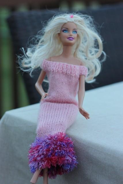 Barbie in her pink sheath dress with an eyelash yarn trim