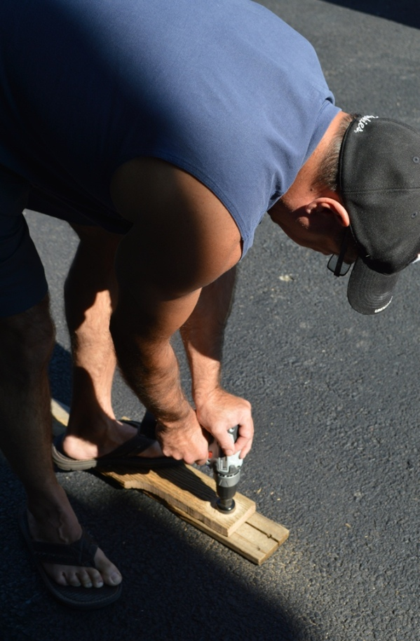 Lee drilling holes in driveway in flip flops.  Don't do this!