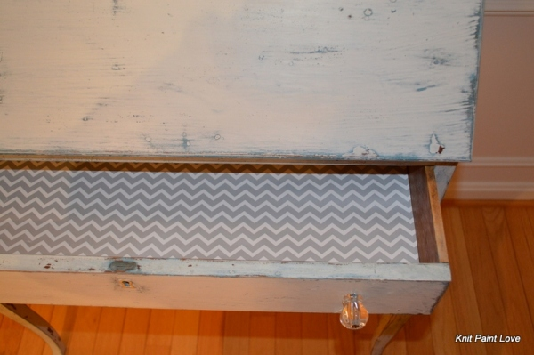 Chevron patterned paper lines the drawers